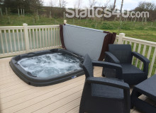 Static caravan for hire with sunken hot tub