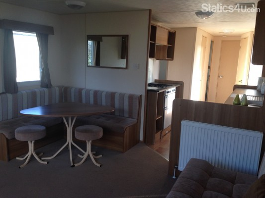2018 caravan holidays for hire cayton bay for Galley kitchen with dining area